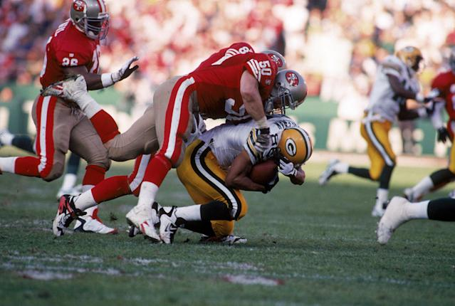 "Linebacker Gary Plummer (50), making a tackle in a 1996 playoff game, lasted 12 seasons in the NFL, including four with the <a class=""link rapid-noclick-resp"" href=""/nfl/teams/sfo/"" data-ylk=""slk:San Francisco 49ers"">San Francisco 49ers</a>. (Getty Images)"