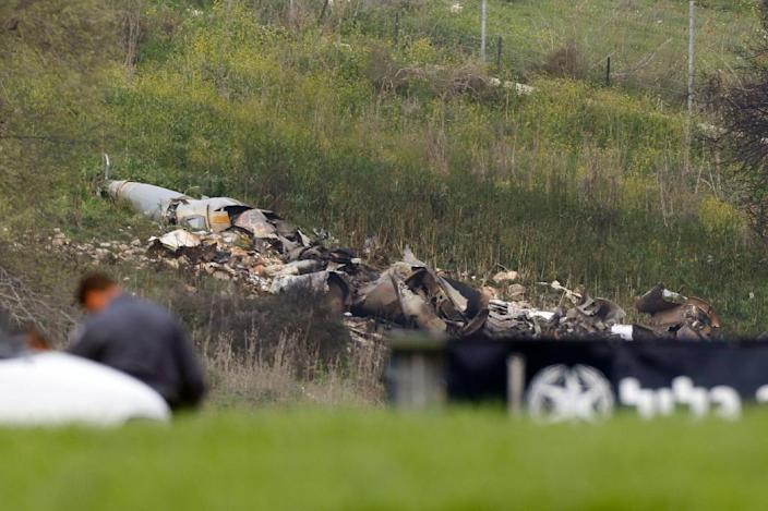 """A picture taken in the northern Israeli Kibbutz of Harduf on February 10, 2018, shows the remains of an Israel F16 that crashed after coming under fire by Syrian air defences during attacks against """"Iranian targets"""" in the war-torn country (AFP Photo/Jack GUEZ)"""