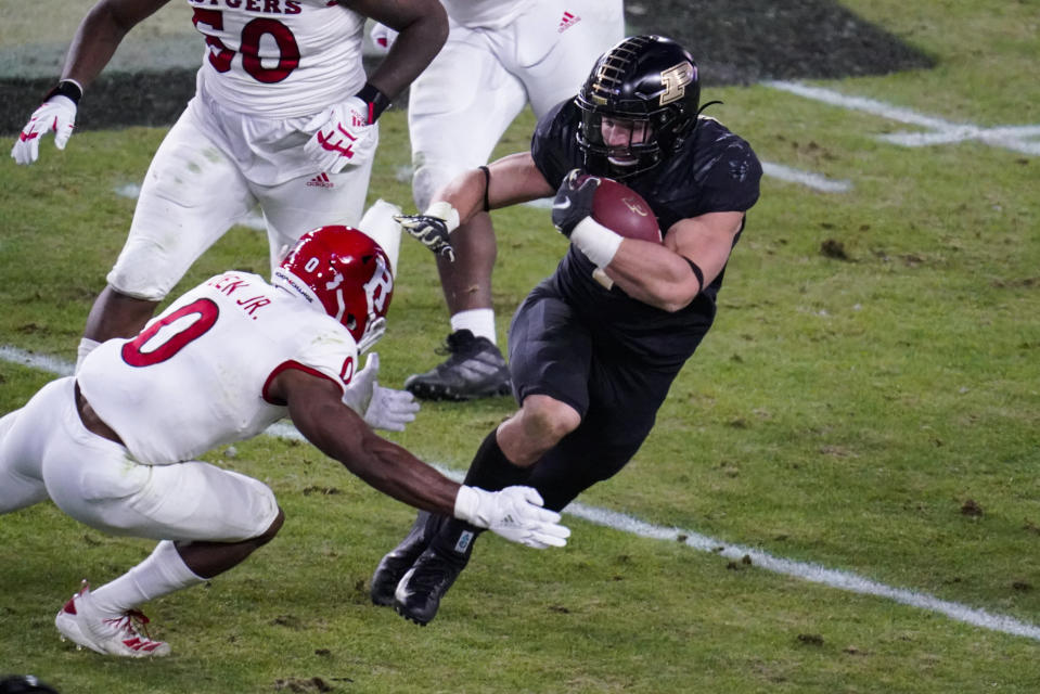 Purdue running back Zander Horvath (40) cuts away from Rutgers defensive back Christian Izien (0) during the second quarter of an NCAA college football game in West Lafayette, Ind., Saturday, Nov. 28, 2020. (AP Photo/Michael Conroy)