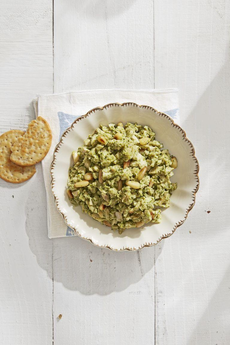 """<p>Your guests will love this delicious pesto chicken salad, packed with crunchy toasted pine nuts and perfect on a cracker or in a sandwich.</p><p><strong><a href=""""https://www.countryliving.com/food-drinks/a30614091/pesto-chicken-salad-recipe/"""" rel=""""nofollow noopener"""" target=""""_blank"""" data-ylk=""""slk:Get the recipe"""" class=""""link rapid-noclick-resp"""">Get the recipe</a>.</strong></p><p><strong><strong><a class=""""link rapid-noclick-resp"""" href=""""https://www.amazon.com/Sabatier-Stainless-Santoku-EdgeKeeper-Self-Sharpening/dp/B01MAYOB2G/?tag=syn-yahoo-20&ascsubtag=%5Bartid%7C10050.g.1642%5Bsrc%7Cyahoo-us"""" rel=""""nofollow noopener"""" target=""""_blank"""" data-ylk=""""slk:SHOP KITCHEN KNIVES"""">SHOP KITCHEN KNIVES</a></strong><br></strong></p>"""