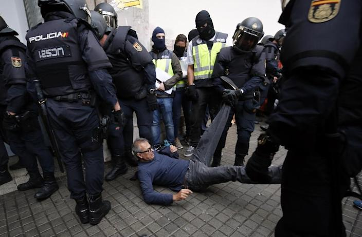 More than 700 people went to hospital as a result of the clashes during the Catalan vote, of whom 92 were confirmed injured (AFP Photo/PAU BARRENA)