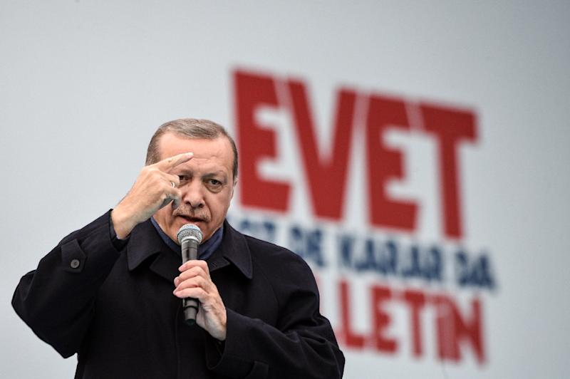 "Turkish President Recep Tayyip Erdogan delivers a speech on April 8, 2017 during a campaign rally for the ""yes"" vote in a constitutional referendum in Istanbul"