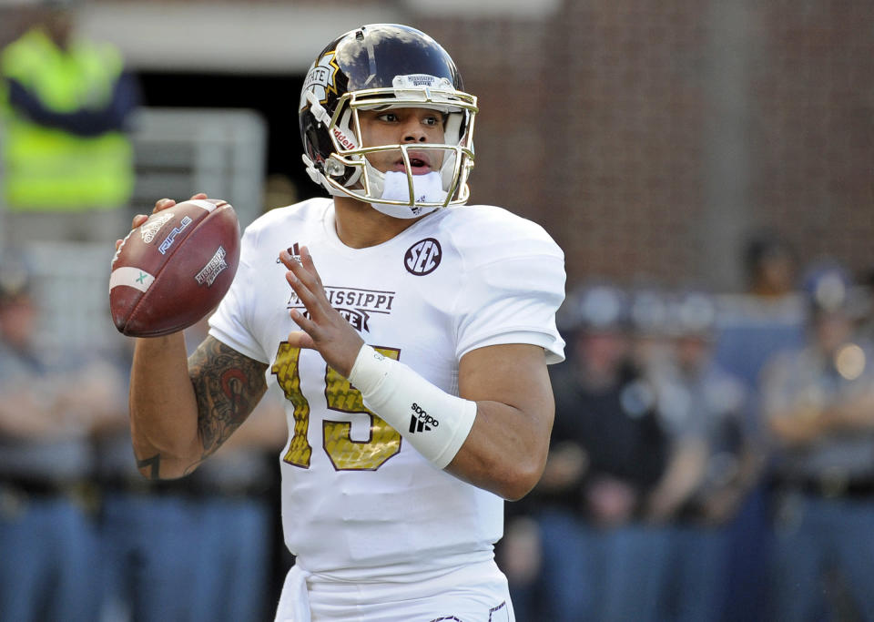 Mississippi State quarterback Dak Prescott (15) looks to pass during the first half of an NCAA college football game against Mississippi in Oxford, Miss., Saturday, Nov. 29, 2014. (AP Photo/Thomas Graning)