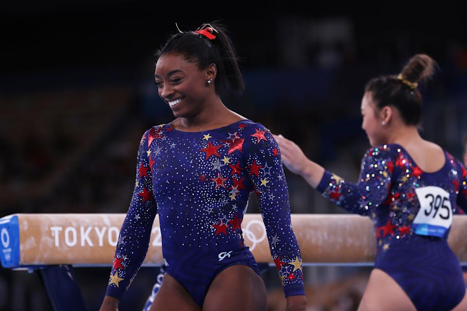 <p>TOKYO, JAPAN - JULY 25: Simone Biles of Team United States l react on day two of the Tokyo 2020 Olympic Games at Ariake Gymnastics Centre on July 25, 2021 in Tokyo, Japan. (Photo by Amin Mohammad Jamali/Getty Images)</p>
