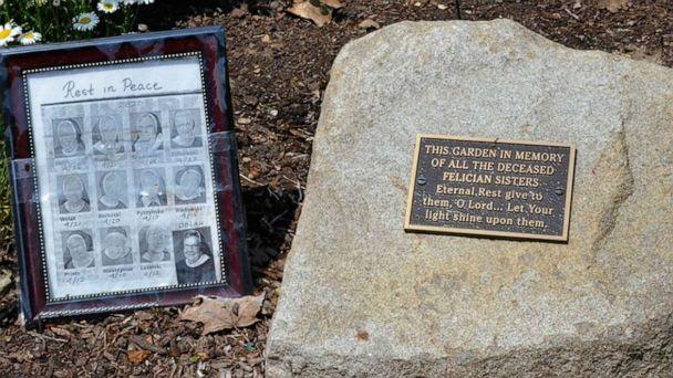 PHOTO: A frame with photos of 12 of the nuns who died from COVID-19 sits in a small memorial in the gardens outside the Felician Sisters' convent in Livonia, Mich. Photo used with permission from the Global Sisters Report. (Dan Stockman/GSR)