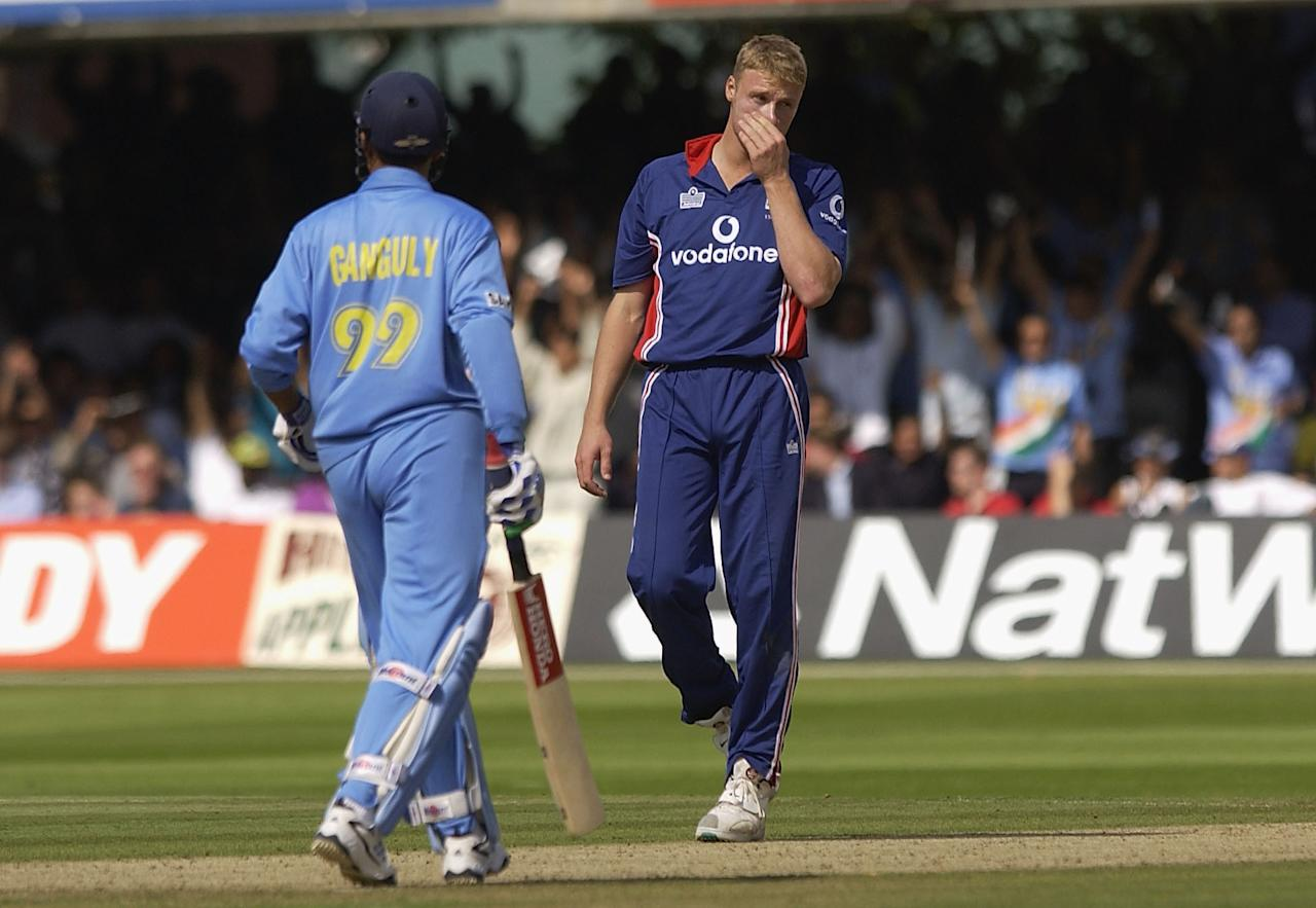 LONDON, ENGLAND - JULY 13:  A dejected Andrew Flintoff of England after Sourav Ganguly of India hits another boundery during the match between England and India in the NatWest One Day Series Final at Lord's in London, England on July 13, 2002. (Photo by Tom Shaw/Getty Images)