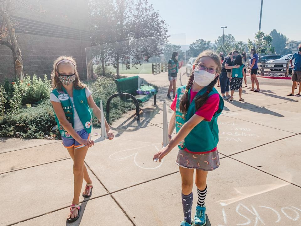 Members of Girl Scout Troop 65430 deliver PPE to their school. (Photo: Randi Bangertner)