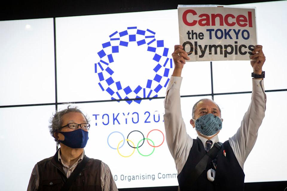 A protester holds a placard during a protest against the Tokyo Olympics on in Tokyo, Japan.
