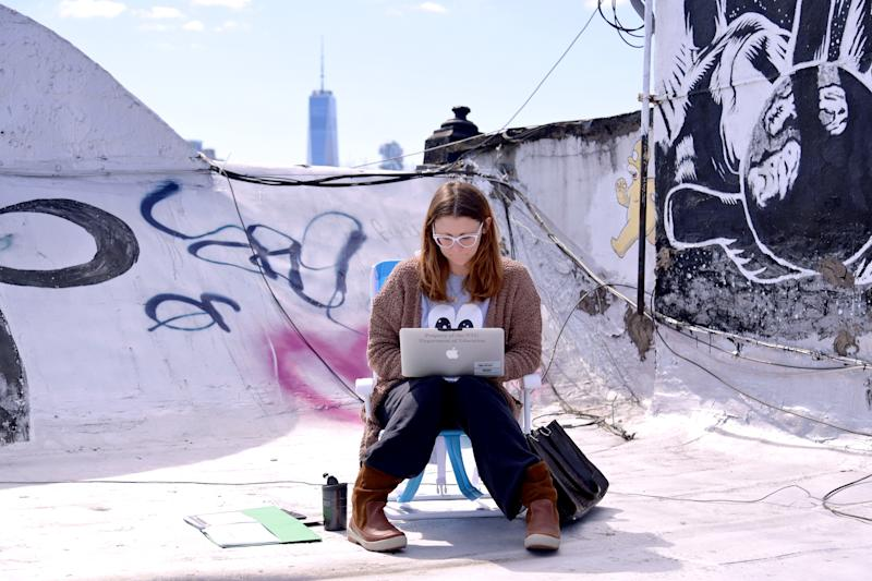 NEW YORK, NY - MARCH 24: A teacher from Yung Wing School P.S. 124 who wished not be identified remote teaches on her laptop from her roof on March 24, 2020 in New York City. Due to the spread of coronavirus (COVID-19), all New York City public schools have launched remote learning programs for all students. (Photo by Michael Loccisano/Getty Images)