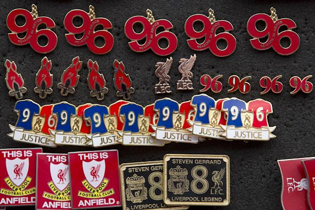 Badges commemorating the victims of the Hillsborough Disaster are seen for sale before Liverpool's English Premier League soccer match against Tottenham at Anfield Stadium, Liverpool, England, Sunday March 30, 2014. Fresh inquests into the deaths of 96 Liverpool fans who were crushed during the FA Cup semi-final at Sheffield Wednesday's Hillsborough stadium on 15 April 1989 will take place in Warrington beginning on March 31. (AP Photo/Jon Super)