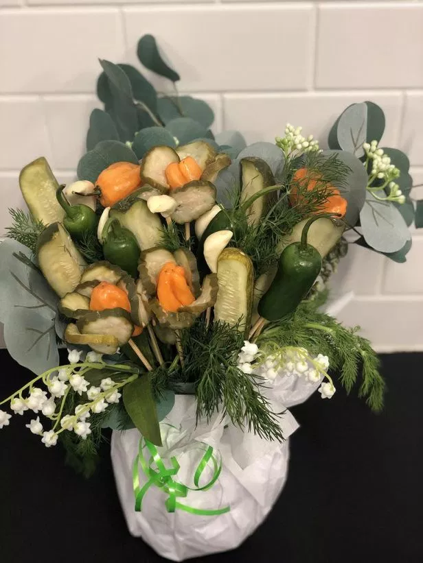 """<strong><h3>Pickle Bouquet</h3></strong><br>Recently seen on a 2020 taping of the <a href=""""https://www.today.com/food/make-pickle-bouquet-valentine-s-day-t147773"""" rel=""""nofollow noopener"""" target=""""_blank"""" data-ylk=""""slk:Today show"""" class=""""link rapid-noclick-resp"""">Today show</a>, Grillo's Pickles founder and CEO, Travis Grillo shared the idea of a Grillo's Italian Dill and Bread & Butter <a href=""""https://www.grillospickles.com/picklebouquet"""" rel=""""nofollow noopener"""" target=""""_blank"""" data-ylk=""""slk:pickles bouquet"""" class=""""link rapid-noclick-resp"""">pickles bouquet</a> and we are SOLD — it's a little bit of a project, but this DIY bouquet will not disappoint."""
