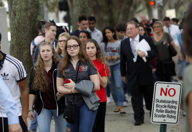 <p>Student survivors from Marjory Stoneman Douglas High School, where over a dozen students and faculty were killed in a mass shooting last Wednesday, march to the state Capitol from the civic center where they slept overnight, to pressure lawmakers on gun control legislation, in Tallahassee, Fla., Wednesday, Feb. 21, 2018. (Photo: Gerald Herbert/AP) </p>