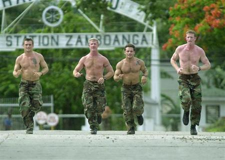 US NAVY SEALS JOG AT PHILIPPINE NAVY HEADQUATERS IN SOUTHERN PHILIPPINES.