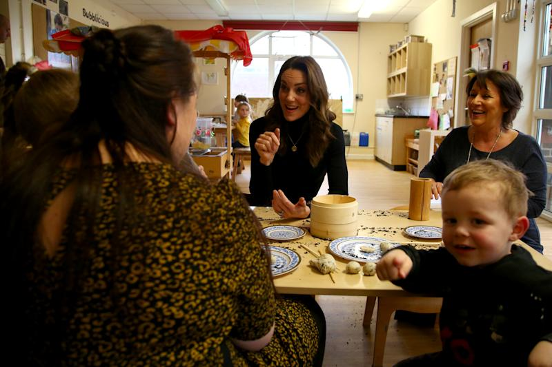 CARDIFF, WALES - JANUARY 22: Catherine, Duchess of Cambridge chats with mothers and their children during a visit to Ely and Careau Children's Centre on January 22, 2020 in Cardiff, Wales. The visit is part of HRH's 24-hour tour of the country to launch '5 big questions on the under 5s'. (Photo by Geoff Caddick - WPA POOL/Getty Images)