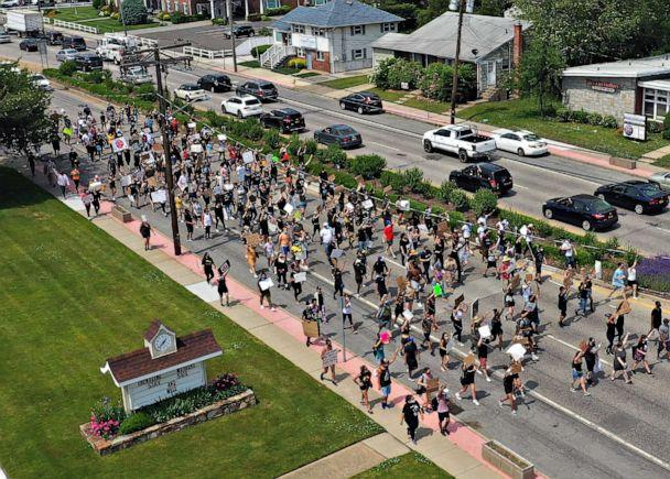 PHOTO: Demonstrators march in support of the Black Lives Matter Movement, on June 06, 2020, in Deer Park, New York. (Bruce Bennett/Getty Images)