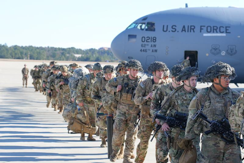 "This handout picture released by the US Army shows U.S. Army Paratroopers assigned to the 2nd Battalion, 504th Parachute Infantry Regiment, 1st Brigade Combat Team, 82nd Airborne Division, deploy from Pope Army Airfield, North Carolina on January 1, 2020. - Paratroopers from 2nd Battalion, 504th Parachute Infantry Regiment, 1st Brigade Combat Team, 82nd Airborne Division were activated and deployed to the U.S. Central Command area of operations in response to recent events in Iraq. (Photo by Capt. Robyn Haake / US ARMY / AFP) / RESTRICTED TO EDITORIAL USE - MANDATORY CREDIT ""AFP PHOTO / Capt. Robyn J. Haake / US ARMY "" - NO MARKETING - NO ADVERTISING CAMPAIGNS - DISTRIBUTED AS A SERVICE TO CLIENTS (Photo by CAPT. ROBYN HAAKE/US ARMY/AFP via Getty Images)"