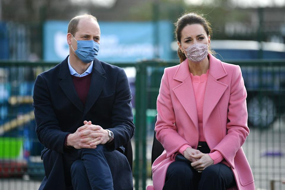 Britain's Prince William, Duke of Cambridge  and Britain's Catherine, Duchess of Cambridge listen during a discussion with teachers and mental health professionals at a visit to School21 following its re-opening after the easing of coronavirus lockdown restrictions in east London on March 11, 2021. - The visit coincides with the roll-out of Mentally Healthy Schools resources for secondary schools and how this is helping put mental health at the heart of their schools curriculum. (Photo by JUSTIN TALLIS / various sources / AFP) (Photo by JUSTIN TALLIS/AFP via Getty Images)