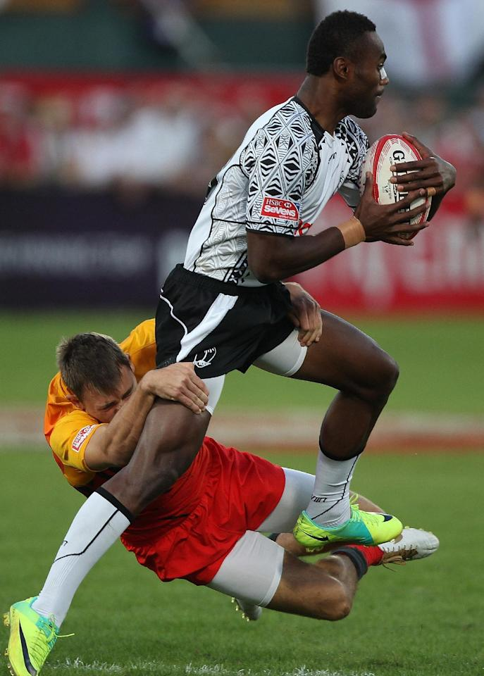 Christian Lewis-Pratt (L) of England challenges Semi Radradra (R) of Fiji during their Dubai Rugby Sevens World Series semi-final match in the Gulf emirate of Dubai on December 3, 2011. England won 19-12 to meet France in the final. AFP PHOTO/MARWAN NAAMANIChristian Lewis-Pratt (L) of England challenges Semi Radradra (R) of Fiji during their Dubai Rugby Sevens World Series semi-final match in the Gulf emirate of Dubai on December 3, 2011. England won 19-12 to meet France in the final. AFP PHOTO/MARWAN NAAMANI (AFP Photo/MARWAN NAAMANI)