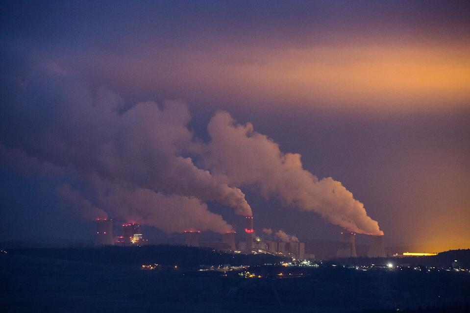A view of Turow Power Plant, a thermal condensing power plant with closed cooling water system in Bogatynia. The basic fuel of the power plant is lignite. On the right, light pollution from the huge greenhouse. Poland generates most of its electricity from coal and lignite or brown coal and is the only EU member not to have pledged to achieve carbon neutrality by 2050. (Photo by Karol Serewis / SOPA Images/Sipa USA)