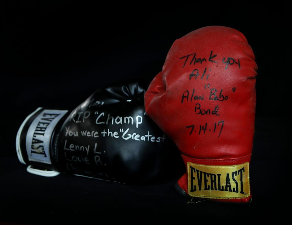 Hundreds of items have been left at Muhammad Ali's gravesite since his burial five years ago.