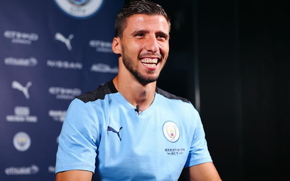 Pep will be hoping Dias looks as happy after the game as he did during his unveiling - GETTY IMAGES