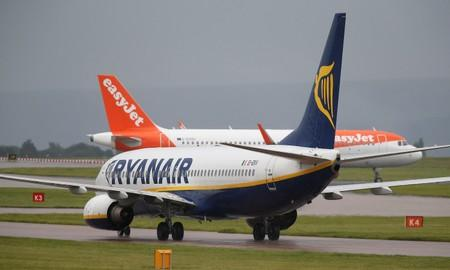 FILE PHOTO: A Ryanair aircraft taxis behind an easyJet aircraft at Manchester Airport