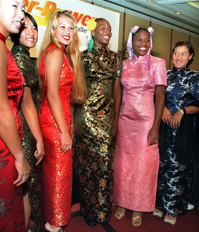 Wearingtraditional Chinese dresses, called cheongsam, at the players' party for the Super Power Challenge Cup on Jan. 6, 1999.
