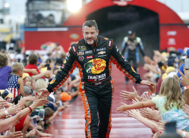 FILE - In this July 2, 2016, file photo, Tony Stewart is greeted by fans during driver introductions before the start of the NASCAR Sprint Cup auto race at Daytona International Speedway in Daytona Beach, Fla. The three-time NASCAR champion headlined the six new nominees eligible for induction into the NASCAR Hall of Fame that were announced Wednesday, March 13, 2019. (AP Photo/Wilfredo Lee, File)