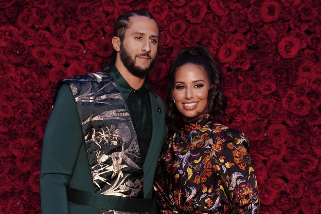 The sneaker Colin Kaepernick, here with longtime partner Nessa in October, created with Nike sold out in hours on Monday. (Elijah Nouvelage/Invision/AP)