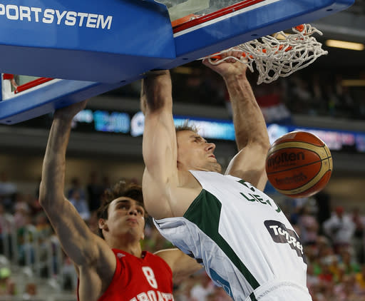 Lithuania's Robertas Javtokas, right, dunks a ball past Croatia's Dario Saric, left, during their EuroBasket European Basketball Championship semifinal match in Ljubljana, Slovenia, Friday, Sept. 20, 2013. (AP Photo/Petr David Josek)
