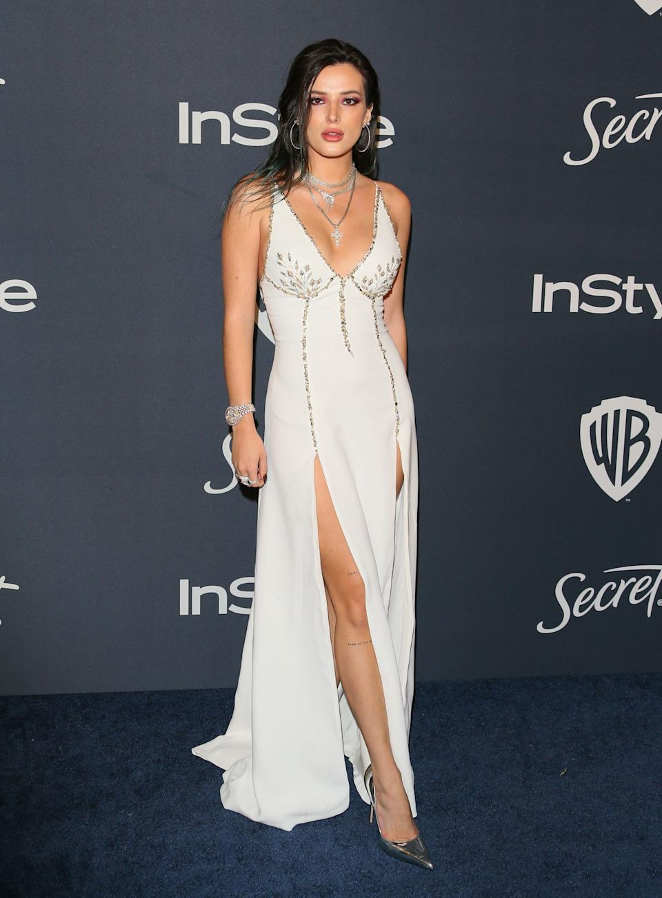 Wearing a white dress with a double thigh-high split. <em>[Photo: Getty]</em>