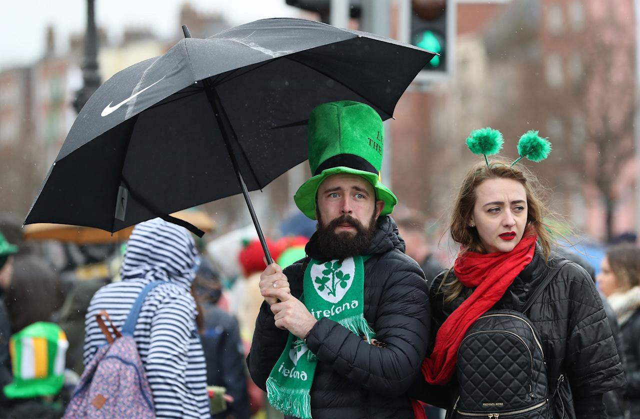 <p>The crowd watch the St Patrick's Day parade on the streets of Dublin. (Brian Lawless/PA Images via Getty Images) </p>