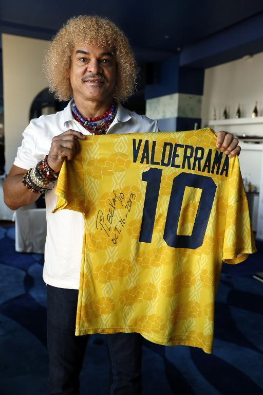 Carlos Valderrama poses with a jersey on October 16, 2013 in Monaco during the 2013 Golden Foot Awards