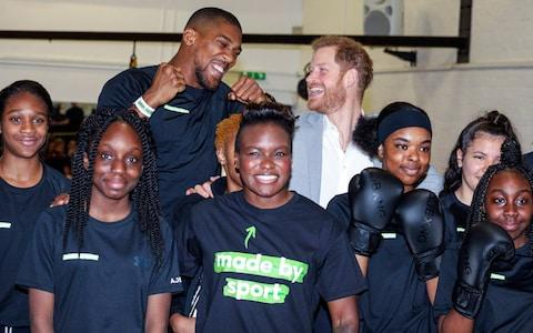 Britain's Prince Harry, top right, and boxers Anthony Joshua, top left, and Nicola Adams, center, pose for the media during the launch of Made by Sport, a new campaign bringing together a coalition of charities supporting disadvantaged young people through sport, at Black Prince Trust in London,  - Credit: Alex Lentati/AP