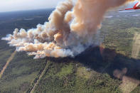This Aug. 15, 2021, photo provided by U.S. Forest Service-Superior National Forest shows a rapidly growing wildfire in northeastern Minnesota that has prompted some evacuations, the U.S. Forest Service said Monday, Aug. 16, 2021. The fire was spotted around 3 p.m. Sunday near Greenwood Lake, about 15 miles southwest of Isabella, in the Superior National Forest. (Nick Petrack/Forest Service-Superior National Forest via AP)