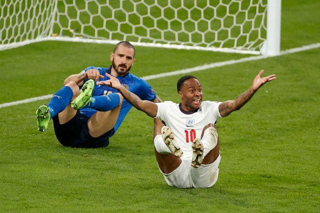England's forward Raheem Sterling (R) reacts after a challenge by Italy's defender Leonardo Bonucci during the UEFA EURO 2020 final football match between Italy and England at the Wembley Stadium in London on July 11, 2021. (Photo by JOHN SIBLEY / POOL / AFP) (Photo by JOHN SIBLEY/POOL/AFP via Getty Images) (Photo: JOHN SIBLEY via Getty Images)