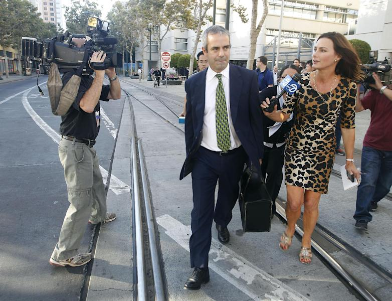 Kevin Johnson, attorney for Samsung, leaves the United States Courthouse and Federal building after a jury reached a decision in the Apple Samsung trial in San Jose, Calif., Friday, Aug 24, 2012. After a year of scorched-earth litigation, a jury decided Friday that Samsung ripped off the innovative technology used by Apple to create its revolutionary iPhone and iPad. The jury ordered Samsung to pay Apple $1.05 billion. An appeal is expected. (AP Photo/Tony Avelar)