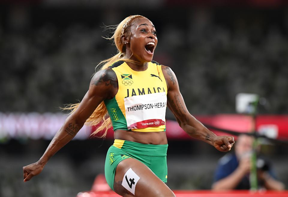 Elaine Thompson-Herah of Jamaica crosses the finish line to win the gold medal in the women's 100m final at the 2020 Tokyo Olympics.