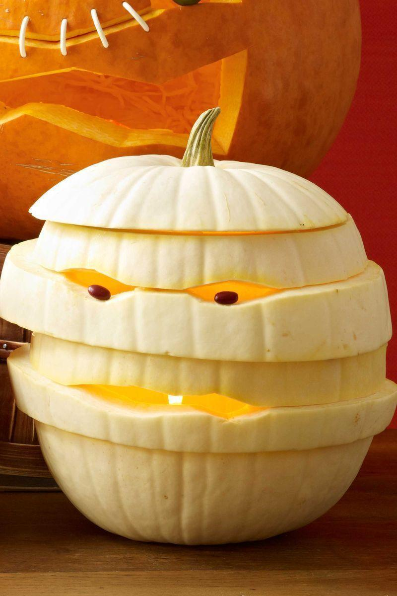 "<p>Stack layers of a cut up pumpkin to create a mummy wrapped-like appearance. Beady bean eyes will send trick-or-treaters running in fear.<strong><br></strong></p><p><strong>Make the Mummy Pumpkin:</strong> Cut off the top one quarter of the pumpkin and scoop out the seeds. Cut pumpkin horizontally all the way around, starting 1"" to 2"" below the opening. Repeat 4 to 6 times until you've carved the whole pumpkin into 1"" to 2"" circles all the way around (don't worry about making your cuts particularly straight). Separate the pieces. Keeping the top and bottom pieces the same, restack the others in a different order. <br></p><p>Rotate the pieces until you get a shape you like, enlarging the carvings for eyes or mouth. Starting from the bottom, lift each level of pumpkin, insert 3 to 4 toothpicks onto the level below, then press down to secure in place. Repeat until entire pumpkin is held together. Place beans into eye holes, securing with half-toothpicks if necessary.</p>"