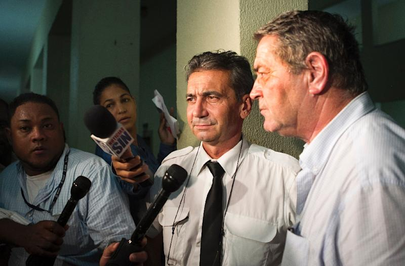French pilot Pascal Fauret (R) and  co-pilot Bruno Odos (2nd-R), accused of trying to fly dozens of suitcases packed with cocaine from the Dominican Republic to France, were convicted for drug trafficking in Santo Domingo on August 15, 2015