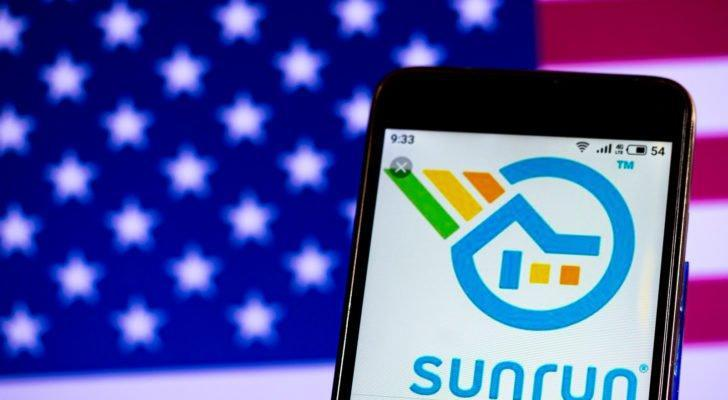 The Sunrun (RUN) logo is displayed on a smartphone screen in front of an American flag.