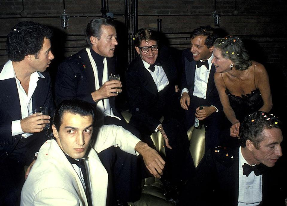 NEW YORK CITY - SEPTEMBER 20: (L-R) David Geffen, Halston, Yves Saint Laurent, Steve Rubell, Nan Kempner and Fernando Sanchez attend 'Opium' Perfume Launch After Party on September 20, 1978 at Studio 54 in New York City. (Photo by Ron Galella, Ltd./Ron Galella Collection via Getty Images)