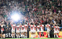 Supporters applaud Japan's players after winning over Ireland during the Rugby World Cup Pool A game at Shizuoka Stadium Ecopa between Japan and Ireland in Shizuoka, Japan, Saturday, Sept. 28, 2019. (Tsuyoshi Ueda/Kyodo News via AP)