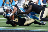 Carolina Panthers running back Christian McCaffrey scores against the New Orleans Saints during the second half of an NFL football game Sunday, Sept. 19, 2021, in Charlotte, N.C. (AP Photo/Jacob Kupferman)