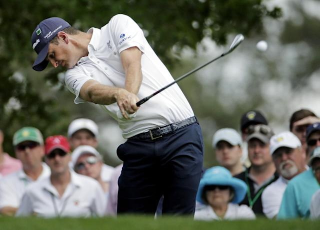Justin Rose, of England, tees off on the fourth hole during the fourth round of the Masters golf tournament Sunday, April 13, 2014, in Augusta, Ga. (AP Photo/Charlie Riedel)