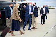 Democratic presidential candidate Joe Biden and his wife Jill Biden board a plane in Philadelphia, Pennsylvania, for the next campaign stop on October 24, 2020