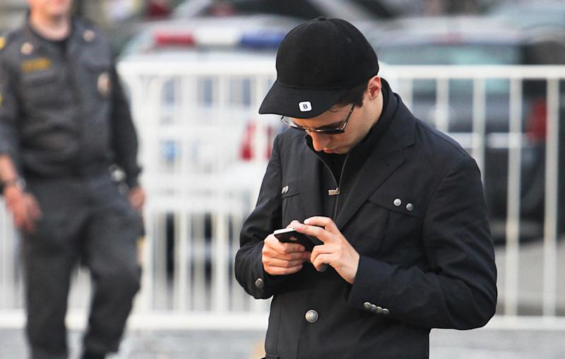 """In this photo taken Saturday, May 19, 2012, Pavel Durov, founder of Russia's leading social network site VKontakte, or """"in contact"""", stands in Red Square in Moscow, Russia. Creator of Russia's leading social network Durov left his post as CEO on Tuesday April 22, 2014, and is understood to have left Russia, one week after he posted online what he said were documents from the security services demanding personal details from 39 Ukraine-linked groups on VKontakte. (AP Photo/Roman Kulik)"""