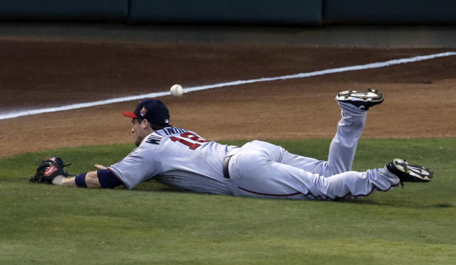 Minnesota Twins left fielder Josh Willingham dives but is unable to stop a run-scoring double by Texas Rangers' Luis Sardinas in the fifth inning of a baseball game, Friday, June 27, 2014, in Arlington, Texas. The hit scored Chris Gimenez. (AP Photo/Tony Gutierrez)