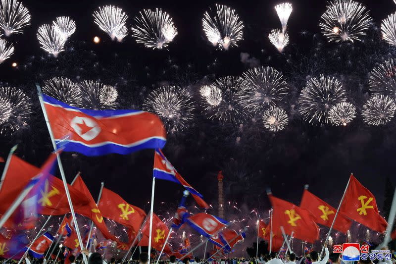 Analysis - North Korea's Kim speaks softly, shows off new military might