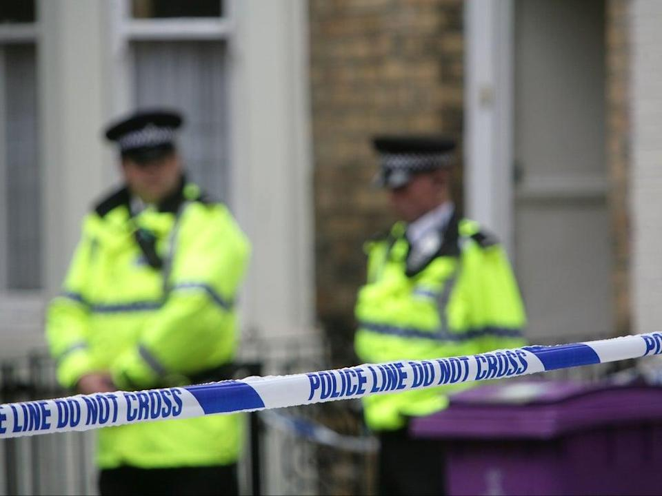 Police officers stand outside a house in Hatherley Street, Liverpool after a raid searching for terror suspects in July 2007 (Getty Images)